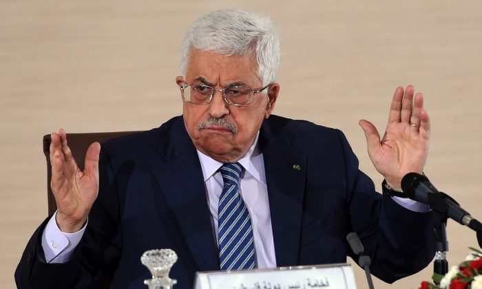 Palestinian President Mahmud Abbas speaks during a press conference held at the Ministry of Foreign Affairs on Dec. 23, 2014, in Algiers. (Farouk Batiche/AFP/Getty Images)