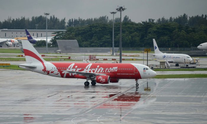An AirAsia flight taxis on the tarmac after landing at at Changi international airport in Singapore on Dec. 29, 2014. A Chinese blogger warned almost two weeks before AirAsia flight QZ8501 went missing on Dec. 28 that disaster would strike Malaysian aielines, including AirAsia. (Mohd Fyrol/AFP/Getty Images)