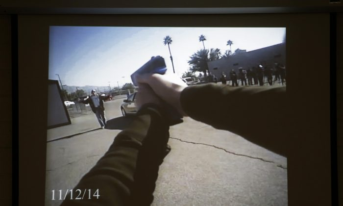 Footage from a Las Vegas police department body camera demonstration is projected on a screen in this Nov. 12, 2014 file photo. (AP Photo/John Locher)