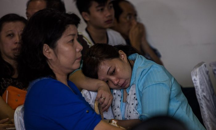 Family members of AirAsia QZ8501 passengers wait for news at the crisis center at Juanda international airport in Surabaya, Indonesia, on Dec. 29, 2014. (Oscar Siagian/Getty Images)