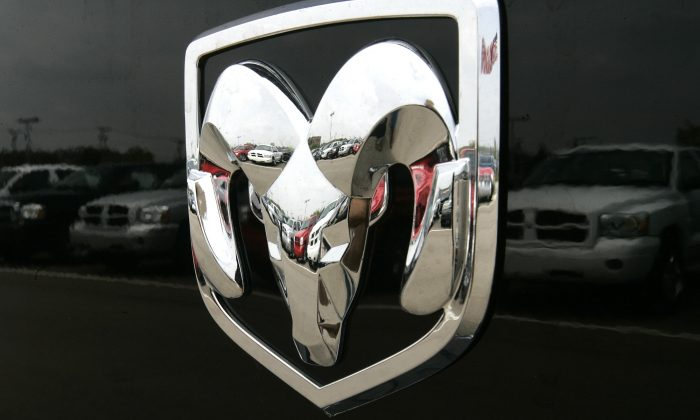 The Dodge logo on a Ram pickup truck at a dealership in Bloomfield Hills, Mich., on July 27, 2006. Fiat Chrysler is recalling about 67,000 model year 2006 and 2007 pickups because of a problem that could prevent the cars from starting, or cause them to move when the ignition key is turned. (AP Photo/Paul Sancya)