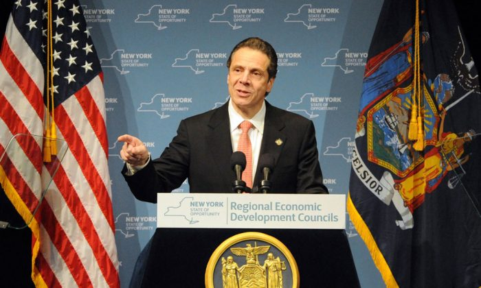Gov. Andrew Cuomo during the Regional Economic Development Council Awards in Albany, N.Y., on Thursday, Dec. 11, 2014. New York officials said Monday that 13 more businesses have agreed to expand to or locate in tax-free zones at colleges and universities across the state while committing to bring new jobs. (AP Photo/Times Union, Michael P. Farrell)