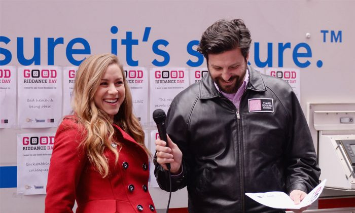 Radio/TV personality Allison Hagendorf and Tim Tompkins of The Times Square Alliance attend The 'Good Riddance Day' Event at Times Square, Broadway Plaza, in NYC, on Dec. 28, 2014. The Times Square Alliance along with Shred-it International collaborated to provide a mobile shredding truck so participants could watch their bad memories be permanently destroyed. (Stephen Lovekin/Getty Images)