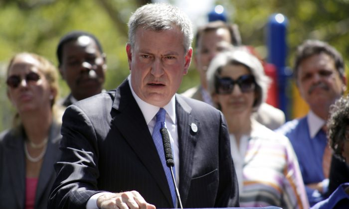 New York City Mayor Bill de Blasio speaks during a press conference in the Brooklyn borough of NYC, on Aug. 28, 2014. Mayor Bill de Blasio is winding down his first year in office, which saw success at fulfilling many of his liberal campaign promises. But the year ends with his young mayoralty facing its biggest crisis yet: an open rebellion from police officers who don't believe the mayor supports them. (AP Photo/Vanessa A. Alvarez)