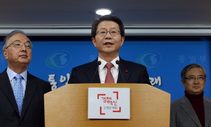 South Korean Unification Minister Ryoo Kihl-jae speaks during a press conference at the government complex in Seoul, South Korea, Monday, Dec. 29, 2014. South Korea on Monday proposed talks with North Korea to discuss what it calls a range of issues needed to prepare for the unification of the divided countries. (AP Photo/Yonhap, Chun Soo-young)