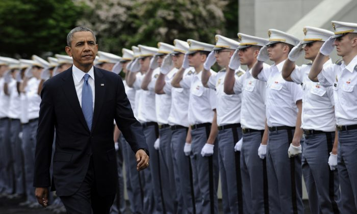 "President Barack Obama arrives to deliver the commencement address to the U.S. Military Academy at West Point's Class of 2014, in West Point, N.Y., on May 28, 2014. As Obama makes the case for U.S. airstrikes in Iraq, he's drawing on a use of force doctrine he outlined less than three months ago, when the potential for deploying the military overseas appeared to be something he was trying to avoid. In a May speech at the U.S. Military Academy, Obama said he would use military force under two scenarios: a direct threat against Americans or U.S. interests and a humanitarian crisis on a scale that he said would ""stir the conscience."" (AP Photo/Susan Walsh)"