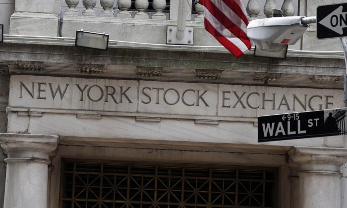 FILE - This Thursday, Oct. 2, 2014, file photo, shows the Wall Street entrance of the New York Stock Exchange.  (AP Photo/Richard Drew)