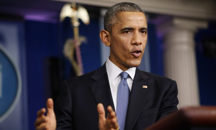 President Barack Obama speaks to members of the media during his last news conference of the year at the White House on Dec. 19, 2014. He faced questions on various topics including the changing of Cuba policy and the computer hack of Sony related to North Korea. (Chip Somodevilla/Getty Images)