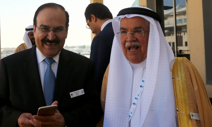 Saudi Oil Minister Ali al-Naimi (R) stands with Bahraini Oil Minister Abdulhussain bin Ali Mirza during the opening session of the 10th Arab Energy Conference in Abu Dhabi on Dec. 21, 2014. (Marwan Naamani/AFP/Getty Images)