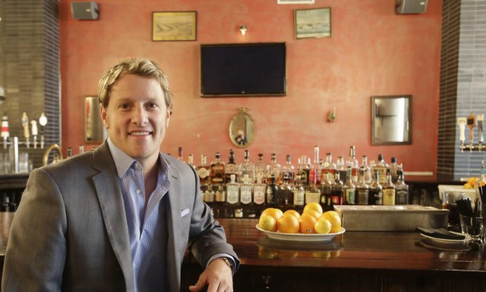 Jayson Seaver poses for a photo in New York's Harding's restaurant, of which he is a part owner, on Dec. 16, 2014. Seaver feels the wealth gap has affected his relationship with his sister. (AP Photo/Mark Lennihan)