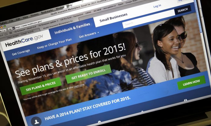 The HealthCare.gov website, where people can buy health insurance, on a laptop screen, shown in Portland, Ore., on Nov. 12, 2014. Being uninsured in America will cost you more in 2015. In 2015, all taxpayers have to report to the Internal Revenue Service for the first time whether or not they had health insurance the previous year. Most will check a box. It's also when the IRS starts collecting fines from some uninsured people, and deciding if others qualify for exemptions. (AP Photo/Don Ryan)