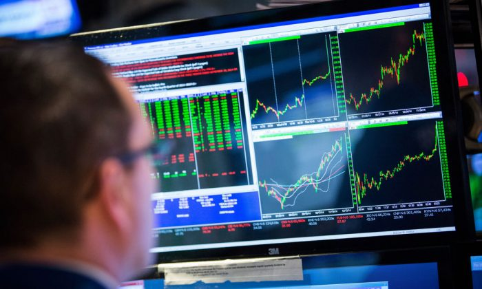 A trader works on the floor of the New York Stock Exchange during the afternoon of Dec. 18, 2014, in New York City. (Andrew Burton/Getty Images)