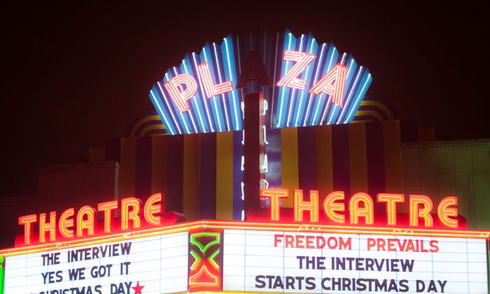 The Plaza Theater marquee advertises Sony Pictures' release of 'The Interview,' Christmas Day, Dec. 25, 2014 in Atlanta, Georgia. Commentators described the attempt to prevent the screening of the movie as a new threat on the American way of life. (Marcus Ingram/Getty Images)