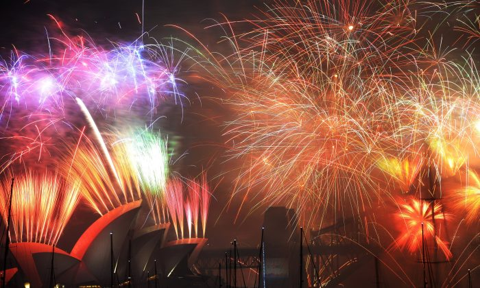 New Year's Eve fireworks erupt over Sydney's iconic Harbour Bridge and Opera House, Australia, during the traditional fireworks show held at midnight on Jan. 1, 2015. (Peter Parks/AFP/Getty Images)