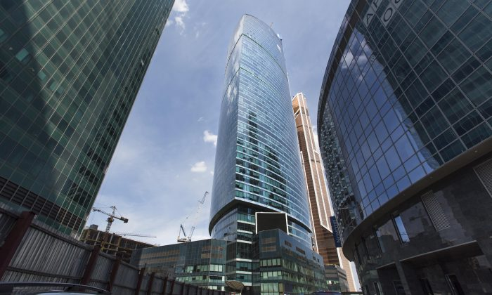 The main VTB Bank building (C) rises between skyscrapers in Moscow, Russia, on July 29, 2014. (AP Photo/Alexander Zemlianichenko)