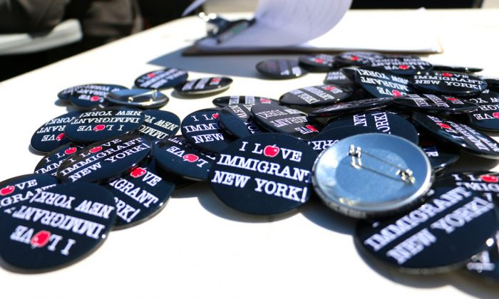 Pins in support of the National Day of Action for Immigration Reform, on April 10, 2014. The New Year begins with the launching of New York City's municipal ID program. (Allen Xie/Epoch Times)