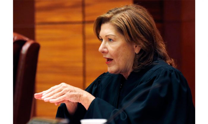 Presiding Justice Karen Peters of the New York Supreme Court Appellate Division Third Department in Albany, N.Y., on Wednesday, Oct. 8, 2014. Parks is one of five Justices who unanimously ruled to uphold an outdoor smoking ban at New York parks. (AP Photo/Mike Groll)