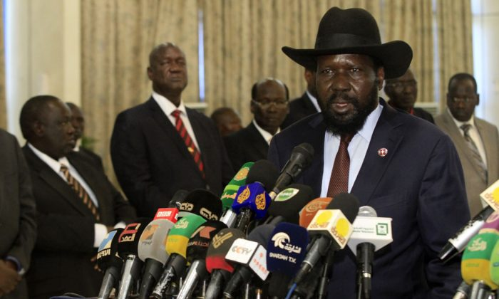 South Sudan's President Salva Kiir (R) attend a press conference at Khartoum's airport on Nov. 4, 2014. (Ashraf Shazly/AFP/Getty Images)