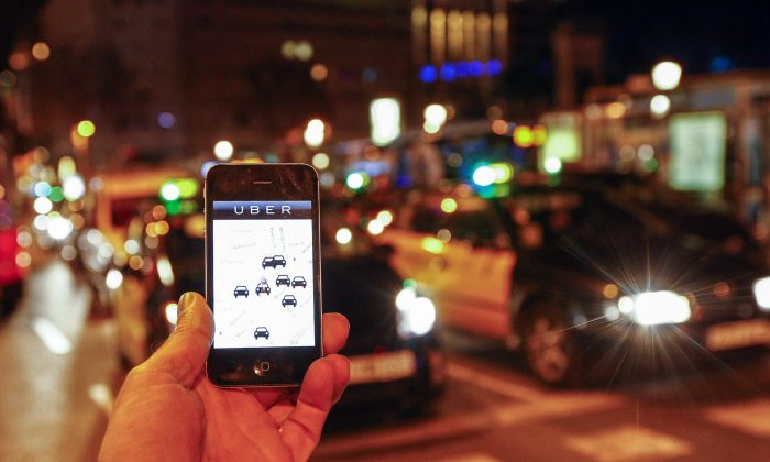 The Uber app on a smartphone in Barcelona on Dec. 9. A judge on Dec. 9 banned the popular smartphone taxi service Uber from operating in Spain. (Quique Garcia/AFP/Getty Images)