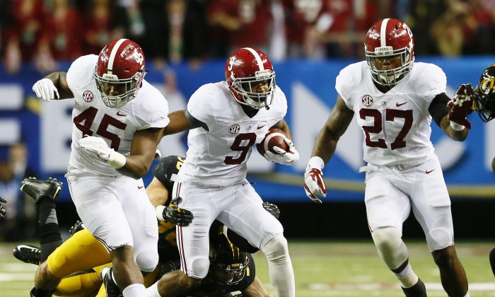 The Alabama Crimson Tide (with the ball) against the Missouri Tigers in the SEC Championship game in Atlanta on Dec. 6, 2014. (Kevin C. Cox/Getty Images)