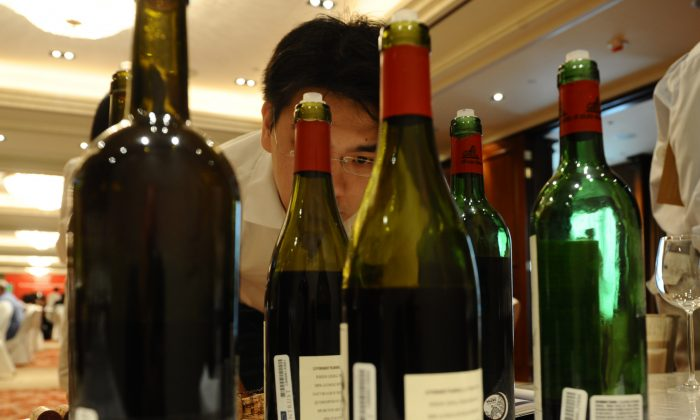 A potential investor at a wine auction in Hong Kong on Sept. 12, 2009. (Antony Dickson/AFP/Getty Images)