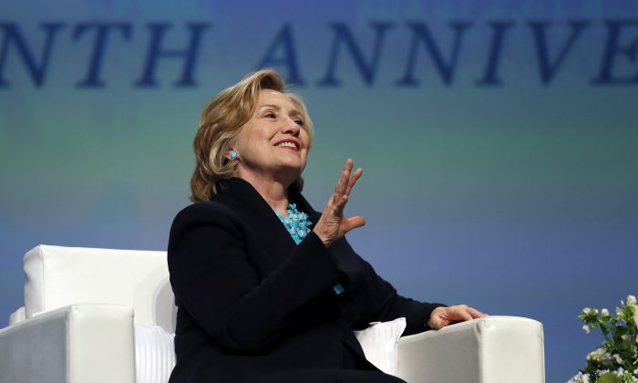 Former Secretary of State Hillary Rodham Clinton speaks in Boston on Dec. 4, 2014. (AP Photo/Elise Amendola)