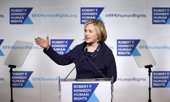 In a Dec. 16, 2014 file photo, former Secretary of State Hillary Rodham Clinton speaks after accepting the Robert F. Kennedy Ripple of Hope Award during a ceremony in New York. (AP Photo/Jason DeCrow, File)