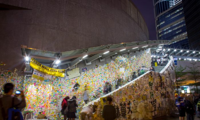 People look at the Lennon Wall on the road outside Hong Kong's Government Complex on Dec. 9, 2014 in Hong Kong. (Chris McGrath/Getty Images)