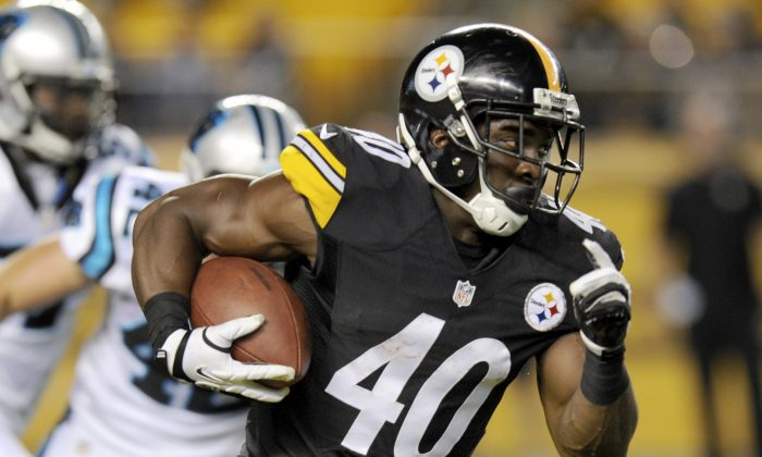 The Pittsburgh Steelers will play the Baltimore Ravens on Saturday at 8:15 p.m. ET on NBC. Meanwhile, ESPN will feature the Arizona Cardinals at the Carolina Panthers at 4:35 p.m. ET.  In this Aug. 28, 2014, file photo, Pittsburgh Steelers running back Josh Harris (40) runs away from Carolina Panthers defensive back Colin Jones (42) in the fourth quarter of a NFL preseason football game in Pittsburgh. While quarterbacks and other big-name, high-salaried players get most of the attention, unlikely heroes often emerge in the playoffs to help their team win. Philly Brown, Josh Harris and Cole Beasley are among the lesser-known players who could step up this wild-card weekend. (AP Photo/Don Wright, File)