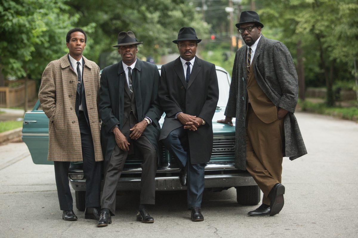 """four black men in suits and hats leaning on car in """"Selma"""""""