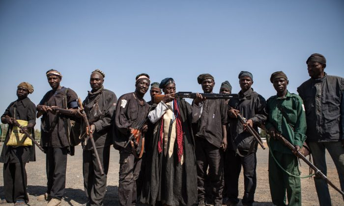 A band of hunters pose in Yola, state capital of Adamawa, on Dec. 4, 2014, after taking part in an operation against Nigerian Islamist extremist group Boko Haram. (Florian Plaucheur/AFP/Getty Images)