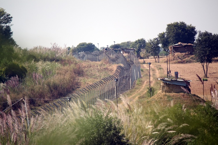 The fence erected within the Indian territory near the India-Pakistan International Border along with floodlights at Chak Changa village at Hiranagar, Jammu State, India, Oct. 2012. (Venus Upadhayaya/The Epoch Times)