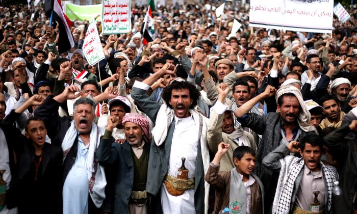 Houthi Shiite rebels chant slogans during a protest near the site of a suicide bombing in Sanaa, Yemen, on Oct. 9, 2014. Yemen's 2011 Arab Spring revolt began with a nucleus of young men and women, a mix of socialists, secularists and moderate Islamists seeking to end autocrat Ali Abdullah Saleh's 33-year rule and transform the poorest Arab nation into a democratic, modern society. In October 2014, nearly four years later, Yemen is in chaos and Shiite rebels have overrun the capital. Saleh is out of power, but remains powerful, with his loyalists infusing the political scene and the military. Attempts at real reform are in disarray. (AP Photo/Abdullrhman Huwais)