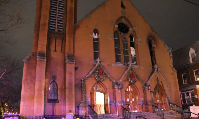 Our Lady of Sorrows Catholic Church after a heavy fire in Corona, Queens, N.Y. on Jan. 4, 2015. (Shannon Liao/Epoch Times)
