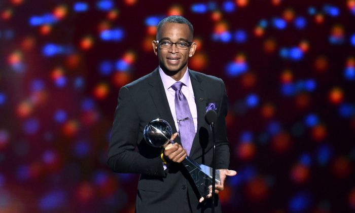 "FILE - In a July 16, 2014 file photo, sportscaster Stuart Scott accepts the Jimmy V award for perseverance, at the ESPY Awards at the Nokia Theatre, in Los Angeles. Scott, the longtime ""SportsCenter"" anchor and ESPN personality known for his known for his enthusiasm and ubiquity, died Sunday, Jan. 4, 2015 after a long fight with cancer. He was 49. (Photo by John Shearer/Invision/AP, File)"