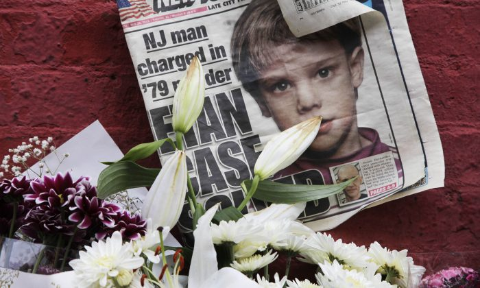 A newspaper with a photograph of Etan Patz that is part of a makeshift memorial in the SoHo neighborhood of New York on May 28, 2012. As the murder case surrounding Patz' notorious 1979 disappearance heads to trial, missing-children's advocates see it as proof that such cases still can be pursued after decades. (AP Photo/Mark Lennihan)