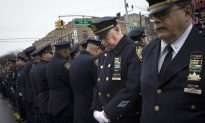 Mayor Eulogizes Officer as Cops Outside Turn Backs