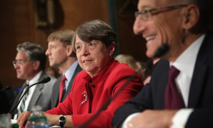 (L-R) Comptroller of the Currency Thomas Curry, Consumer Financial Protection Bureau Director Richard Cordray, Chair of the Securities and Exchange Commission Mary Jo White, and Chairman of the Commodity Futures Trading Commission Timothy Massad testify during a hearing before the Senate Banking, Housing, and Urban Affairs Committee in Washington, D.C., on Sept. 9, 2014. (Alex Wong/Getty Images)