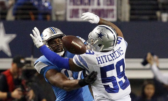 """An article saying Dallas Cowboys-Detroit Lions referee Pete Morelli quit his job after """"coming into $500,000"""" is fake. Dallas Cowboys outside linebacker Anthony Hitchens (59) gets hit in the back by a pass intended for Detroit Lions tight end Brandon Pettigrew (87) during the fourth quarter of an NFL wildcard playoff football game, Sunday, Jan. 4, 2015, in Arlington, Texas. (AP Photo/The Fort Worth Star-Telegram, Richard W. Rodriguez)  MAGS OUT; (FORT WORTH WEEKLY, 360 WEST); INTERNET OUT"""