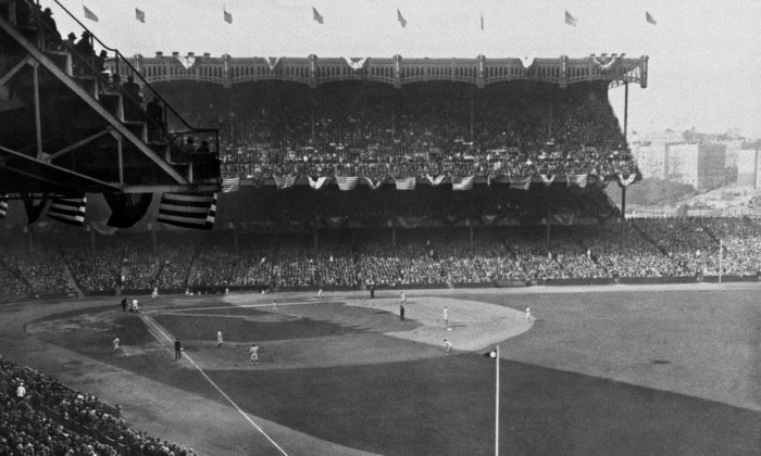 More than 60,000 fans jam Yankee Stadium for Game 3 of the 1927 World Series between the New York Yankees and the Pittsburgh Pirates, October 7, 1927. New York lefthander Herb Pennock took a perfect game into the eighth inning, until Pirates third baseman Pie Traynor singled with one out. Pennock finished the game, giving up just three hits, as the Yankees won 8-1. They went on to sweep the overmatched Pirates in four games for their second world championship. In his career, Pennock went 5-0 in World Series starts, all with the Yankees. (AP Photo)