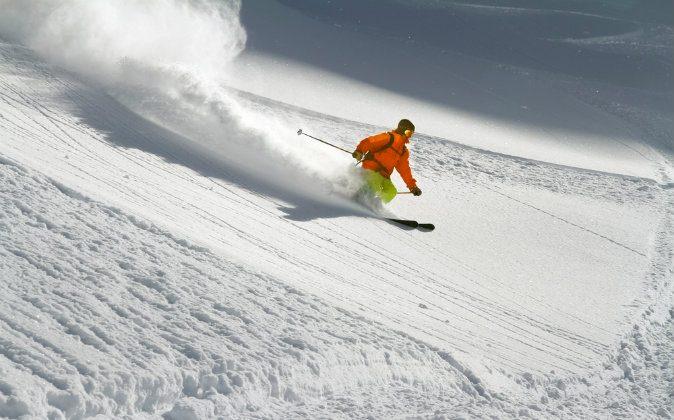 Skier in deep powder snow via Shutterstock*