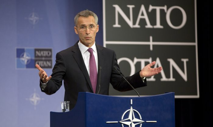 NATO Secretary-General Jens Stoltenberg at a media conference prior to a meeting of the North Atlantic Council at NATO headquarters in Brussels on Dec. 2, 2014. (AP Photo/Virginia Mayo)
