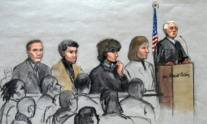 In this courtroom sketch, Boston Marathon bombing suspect Dzhokhar Tsarnaev (3rd R) is depicted with his lawyers and U.S. District Judge George O'Toole Jr. (R), as O'Toole addresses a pool of potential jurors in a jury assembly room at the federal courthouse, Tuesday, Jan. 6, 2015, in Boston. Tsarnaev is charged with the April 2013 attack that killed three people and injured more than 260. His trial is scheduled to begin on Jan. 26. He could face the death penalty if convicted. (AP Photo/Jane Flavell Collins)
