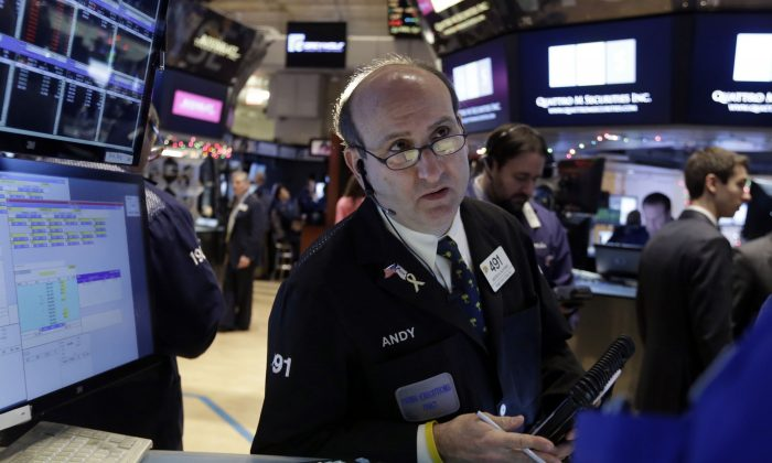 Trader Andrew Silverman works on the floor of the New York Stock Exchange Tuesday, Jan. 6, 2015. (AP Photo/Richard Drew)