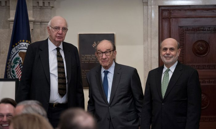 US Federal Reserve chairman Ben Bernanke (R) and former chairmen Alan Greenspan (C) and Paul Volcker pose during a ceremony marking the centennial of the founding of the Federal Reserve in Washington on Dec. 16, 2013. (Nicholas Kamm/AFP/Getty Images)