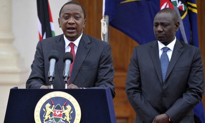 Kenyan President Uhuru Kenyatta delivers his state of the nation speech next to Vice President William Ruto (R) at the State House in Nairobi on Dec. 2, 2014. (Simon Maina/AFP/Getty Images)