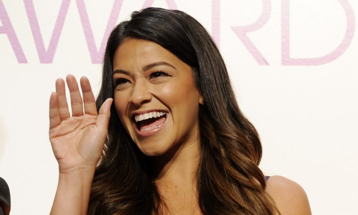 Actress Gina Rodriguez waves from the stage during the nominations for the People's Choice Awards 2015 on Tuesday, Nov. 4, 2014, in Beverly Hills, Calif. The annual awards show will be held on Jan. 7, 2015 at the Nokia Theatre in Los Angeles. (Photo by Chris Pizzello/Invision/AP)