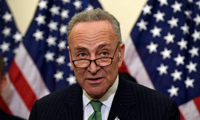 Sen. Charles Schumer (D-N.Y.) during a news conference on Capitol Hill in Washington on Wednesday, Jan. 7, 2015. Schumer is calling for daily federal screening of airport and airline workers for weapons following last month's arrests of five men accused of smuggling guns through the New York and Atlanta airports. (AP Photo/Susan Walsh)