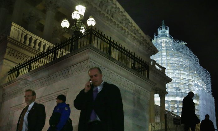 Members of the U.S. House of Representatives leave the Capitol after a vote on the $1.1 trillion omnibus bill Dec. 11, 2014. (Alex Wong/Getty Images)