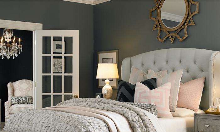 A tufted headboard makes a stunning focal point and adds an element of sophistication and elegance to a guest bedroom. (Courtesy of Bassett Furniture)
